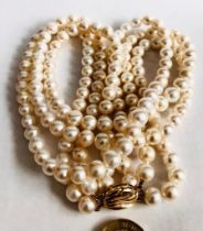 CULTURED PEARL THREE STRAND NECKLACE HAVING 9ct GOLD CLASP