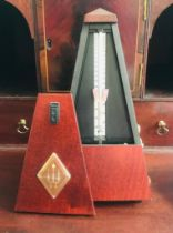 MAHOGANY COLOURED CASED CONTEMPORARY METRONOME BY WITTER, APPROXIMATELY 22cm HIGH