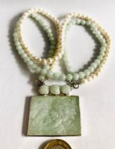 JADE RECTANGULAR PENDANT UPON JADE AND BAROQUE PEARL NECKLACE, APPROXIMATELY 40cm LONG