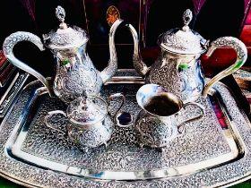 GOOD QUALITY INDIAN SILVER COLOURED METAL UNHALLMARKED TEA SET COMPRISING OF TRAY, TEAPOT, JUG,