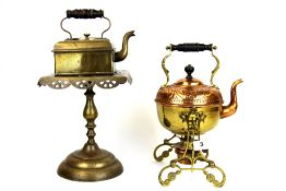 An Art Nouveau hammered copper and brass spirit kettle on stand, H. 32cm. Together with a hammered