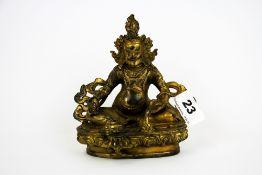 A Tibetan gilt bronze figure of a seated Deity, H. 15cm.