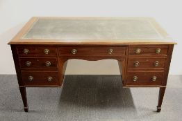 A Victorian mahogany desk with an inset green leather top, 76 x 74 x 136cm.