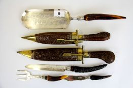 An Eastern brass and wood sheathed carving set together with four items of horn and silver plate.