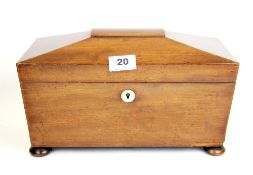 An early 19th Century mahogany tea box with hinged caddies and original mixing bowl with a mother of