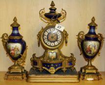 A 19th Century French three piece gilt bronze and porcelain clock garniture, H. 35cm.