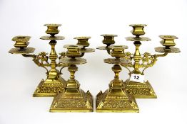A pair of 19th Century brass candelabra and matching candle sticks. Candelabra H. 19cm. Each with