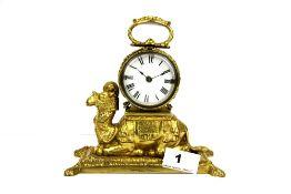 A Victorian gilt brass mantle clock, H. 17cm.
