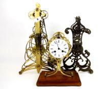 Three skeleton clock part movements.