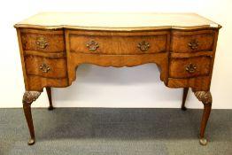 A lovely 1920's walnut veneered dressing table, W. 114cm. H. 77cm.