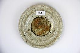 A Chinese crackle glazed porcelain ink grinding bowl, Dia. 19cm. D. 3cm.