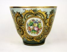 A superb Bohemian gilt and hand painted green glass vase, H. 17cm. Dia. 22cm.