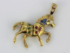 A 9ct yellow gold stone set horse shaped pendant, 3 x 3.5cm.