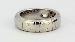 A white metal (tested 18ct gold) diamond set ring, (N).
