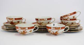 A set of six Japanese tea cups, saucers and side plates.