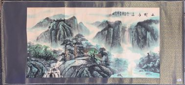 A Chinese silk mounted hand painted scroll of a mountain landscape with waterfall, 183cm x 79cm.