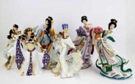 A group of six Danbury Mint porcelain figurines with boxes, H. 26cm.