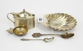 A hallmarked silver shell dish, silver mustard pot (no liner), two silver spoons and a French silver