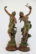A pair of 19th century French Art Nouveau painted spelter figures after Louis Moreau, 'Charmeuse'