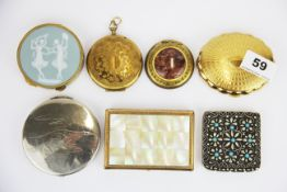 A group of seven vintage compacts.