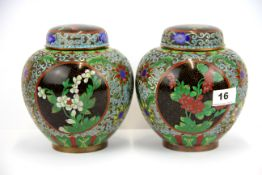 A pair of mid-20th century Chinese cloisonne on copper jars and lids, H. 17cm.