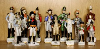 A group of 13 hand painted porcelain figures of historical soldiers, tallest H. 26cm.