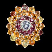 A 925 silver large cluster ring set with fancy colour sapphires, tanzanite and rodolite garnets, (