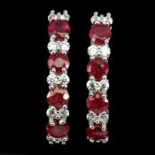 A pair of 925 silver earrings set with swiss cut rubies and white stones, L. 2.1cm.