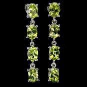 A pair of 925 silver drop earrings set with oval cut peridots, L. 3.1cm.