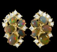 A pair of 925 silver gilt earrings set with cabochon cut opals and white stones, L. 2.5cm.