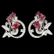 A pair of 925 silver earrings set with rubies and white stones, L. 1.8cm.