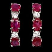 A pair of 925 silver earrings set with rubies and white stones, L. 1.5cm.