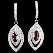 A pair of 925 silver drop earrings set with marquise cut garnet and white stones, L. 3.2cm.