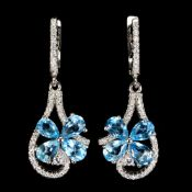 A pair of 925 silver flower shaped drop earrings set with pear cut blue topaz and white stones, L.