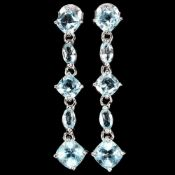 A pair of 925 silver drop earrings set with cushion and marquise cut blue topaz, L. 3.8cm.