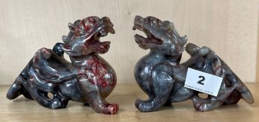 A pair of Chinese carved soapstone dragon figures, H. 10cm. L. 15cm.