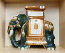 An oriental hand painted ceramic elephant garden stool, H. 38cm.