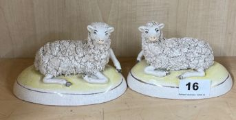 A pair of Staffordshire figures of sheep, W. 13cm. H. 9cm.