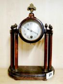 An early 20th C walnut and brass mounted clock, H. 29cm.