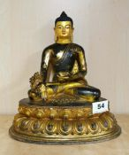 A Tibetan temple quality gilt and hand painted bronze figure of a seated Buddha, H. 27cm.