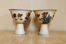 A pair of Chinese hand painted porcelain stem cups, H. 8cm. One is A/F.