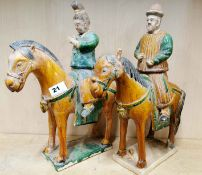 A pair of Chinese Tang Dynasty style glazed pottery horses and riders with detachable heads, H.