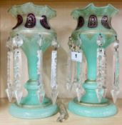 A pair of early 19th Century painted and gilt green glass decorated Bohemian lustres, H. 26.