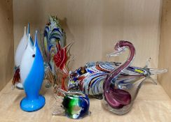 A group of mixed glass fish and other items.