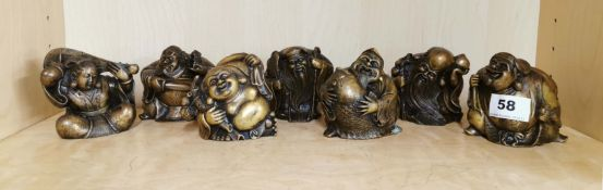 A group of seven Chinese bronze figures of immortals, H. 9cm.