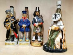 Three unopened porcelain figural decanters and a porcelain lamp base, H. 33cm.