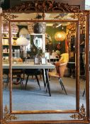A large French antique style gilt framed mirror with bevelled glass panels, W. 136cm x H. 193cm.