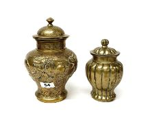 Two early 20th Century Chinese bronze/brass jars and lids, one decorated with dragons, H. 23cm H.