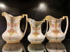 Three 19th C Crown Devon graduated pottery jugs, largest 21cm.