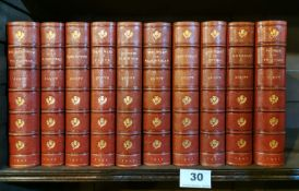 Ten red leather bound volumes of Scott's Novels published by McMillan and Co '1901' bound by Riviere